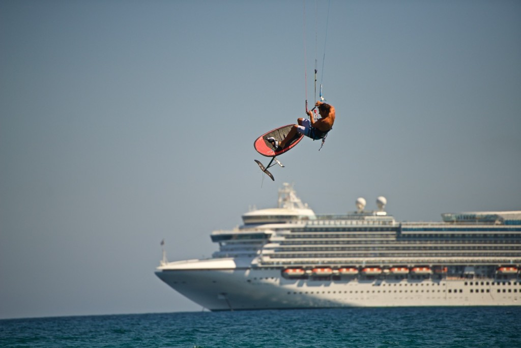 I wonder what the cruise ship folks are thinking is dragging under his board. it ain't kelp... photo: Jim Brewer