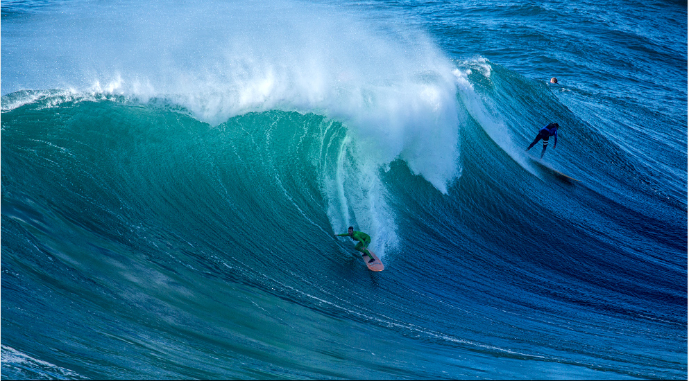 "when a 10'4"" doesn't look big, you know it's a massive wave! photo courtesey: Surfline.com"