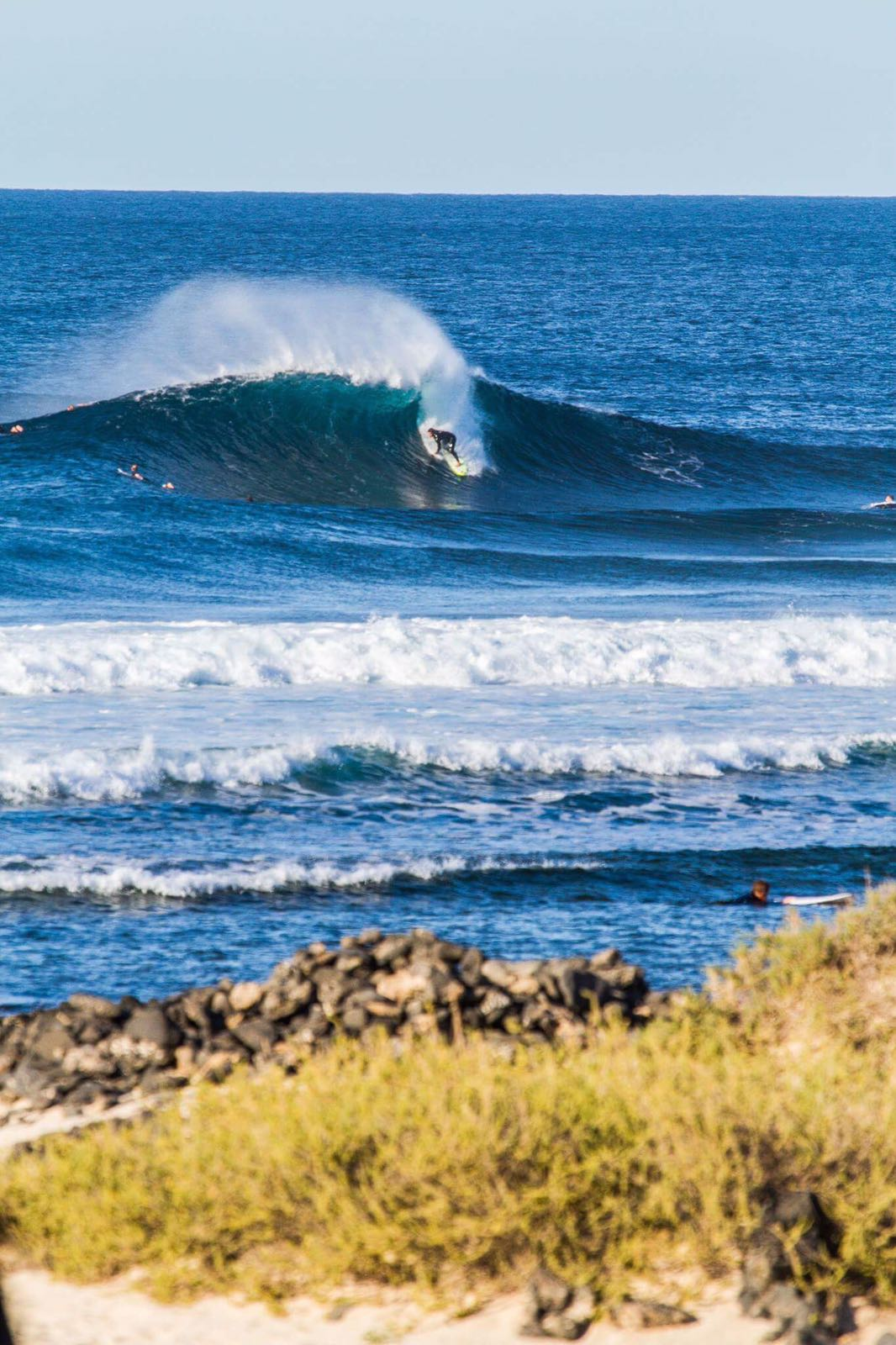 sancho slips into a goodie to evaluate quad fin placement back home. photo: manu migueles